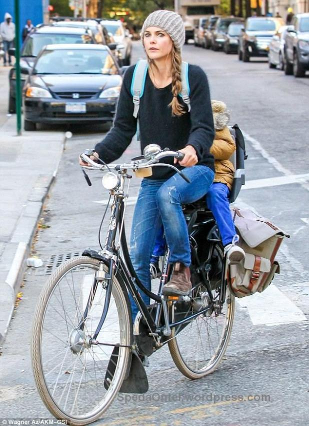 Keri Russell rides her kid to school